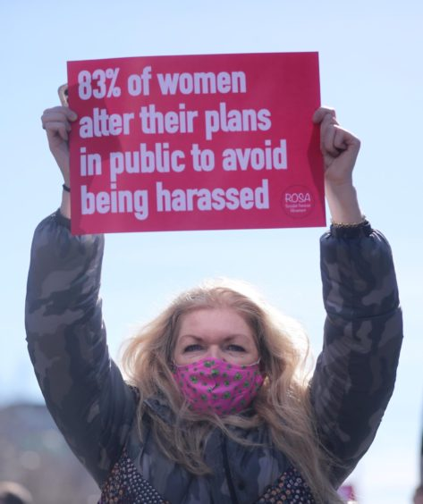 A demonstrator at a protest in Dublin organised in remembrance of Sarah Everard.