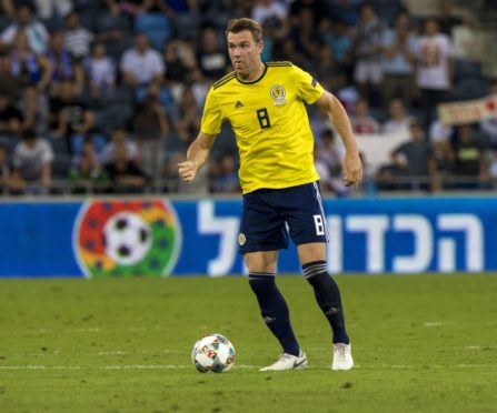 Kevin McDonald in action for Scotland against Israel.