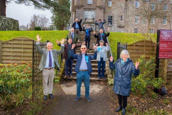 Tory Frank Smith Scottish celebrates alongside party members.