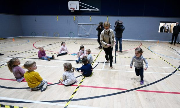 SNP leader Nicola Sturgeon took some time out from campaigning to play with some Insch children