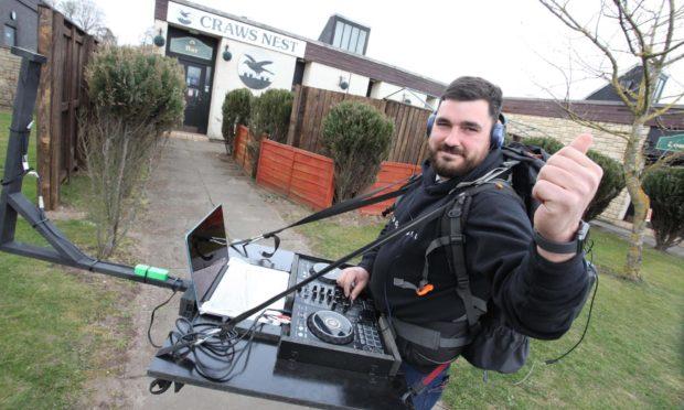 John Starrs with his mobile DJ set-up.