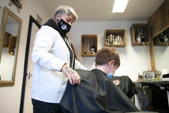 Georgia Gaffney cutting Luke Crichton's hair, House of Handsome, Dundee Street, Carnoustie.