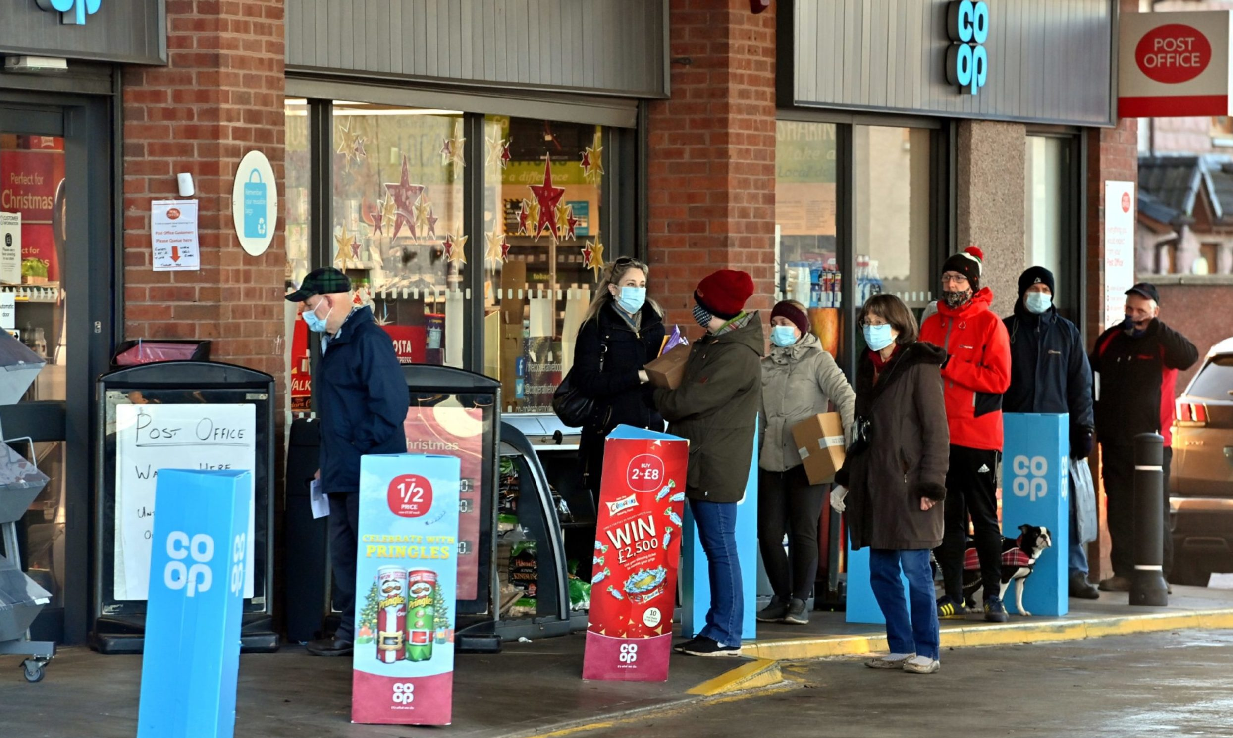 Queues formed outside the Post Office in Stonehaven, integrated into the Kirkton Road Co-Op petrol station, in the days before Christmas 2020.