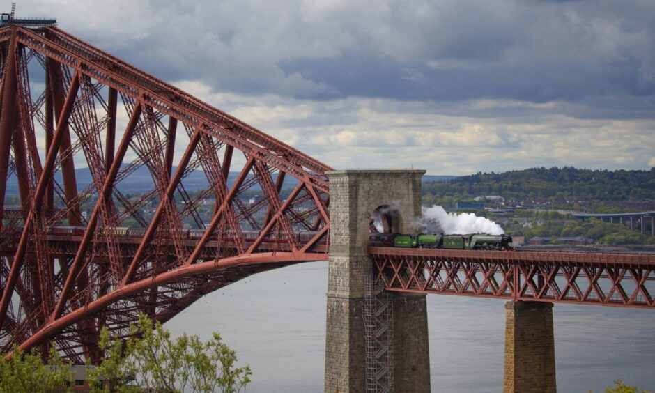 The Flying Scotsman crosses the Forth Bridge on its way from Edinburgh to Inverness in 2019.