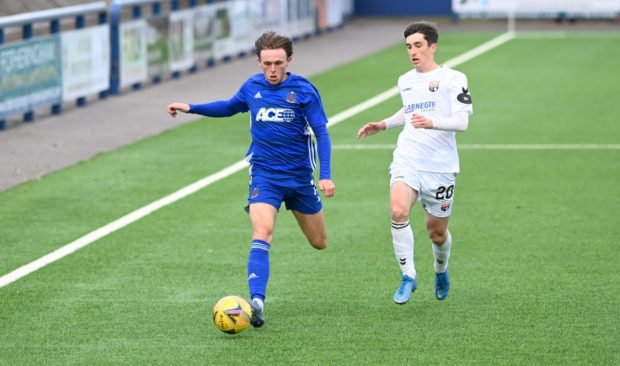 Cove's Broque Watson goes up against Montrose's Chris Mochrie.