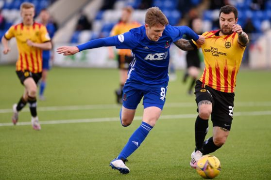 Cove midfielder Blair Yule tussles with Richard Foster of Partick Thistle.