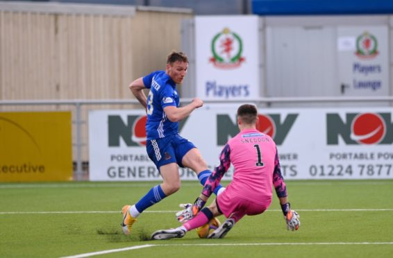 Cove's Rory McAllister sees a shot blocked by Partick's James Sneddon.