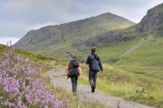 To go with story by Lauren Robertson. The National Trust for Scotland have announced the staggered reopening of their heritage sites from April 26. Picture shows; Walkers in Glencoe. Glencoe. Supplied by National Trust for Scotland Date; Unknown