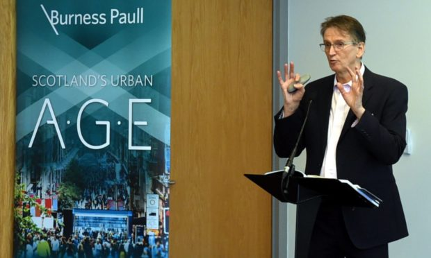 Prof Brian Evans speaking at the unveiling of the 100-page Urban Age report in 2018.