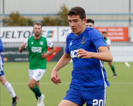 Ross Graham in Betfred Cup action for Cove Rangers against Hibernian.