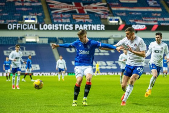 Cedric Itten of Rangers shields the ball from Ross Graham of Cove Rangers.