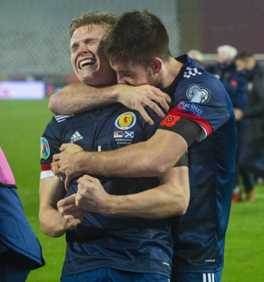 Scotland's Scott McTominay (left) and Declan Gallagher celebrate after David Marshall saves Aleksandar Mitrovic's penalty during the UEFA Euro 2020 Qualifier against Serbia.