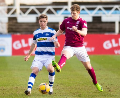 Morton's Michael Ledger (L) is tackled by Jack Hamilton of Arbroath during a Scottish Championship match.