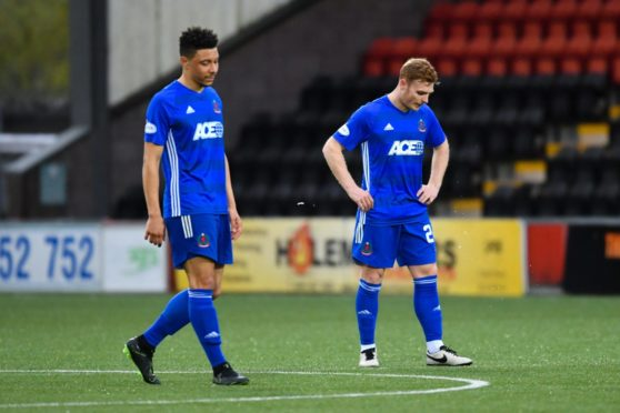 Cove's Fraser Fyvie (R) and Leighton McIntosh at full-time against Airdrieonians.