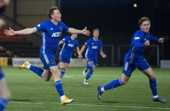 Cove's Rory McAllister (L) celebrates making it 2-1.