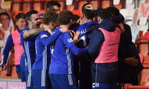Cove's Rory McAllister (centre) celebrates making it 2-1 with his teammates.