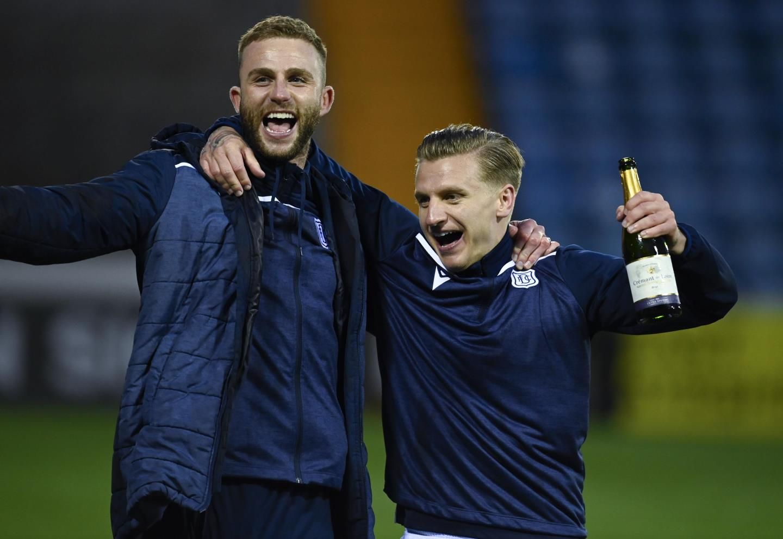 Dundee's Jason Cummings (R) and Christie Elliott at full time.