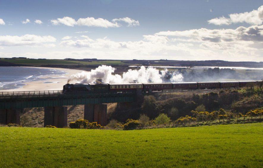 The steam train Tornado making its way past Lunan Bay. Pic: Paul Reid.