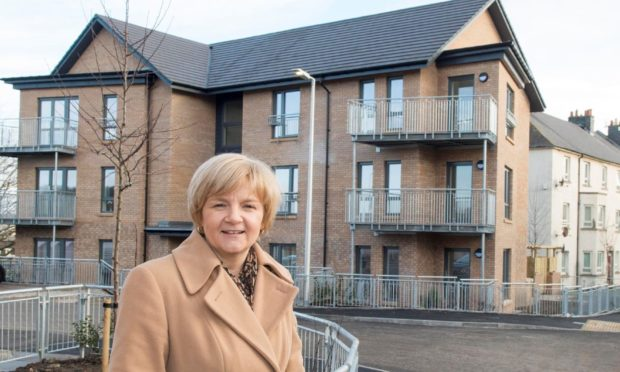 Administration leader Jenny Laing at Manor Walk, where dozens of new council homes were completed in 2017 as part of the 2,000-home pledge.