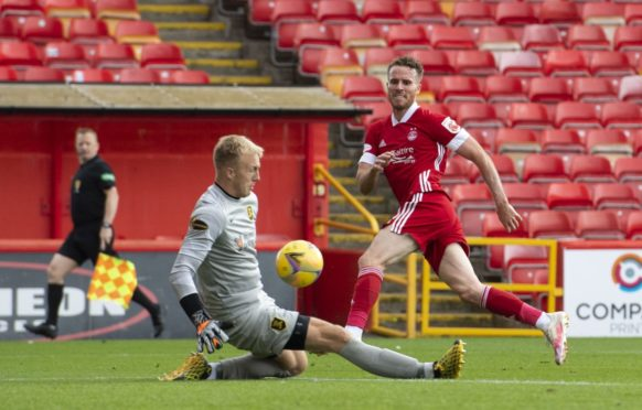 Marley Watkins is denied by Livingston goalkeeper Robby McCrorie while playing for Aberdeen.