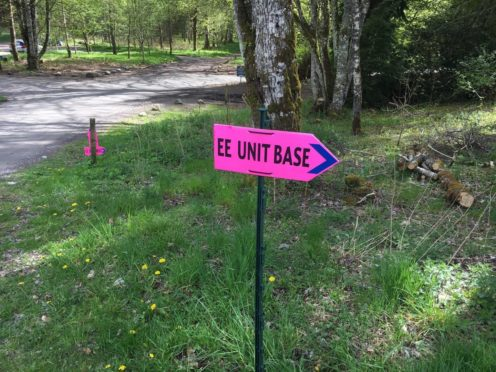 A pink sign reading 'EE Unit Base' in Blair Atholl