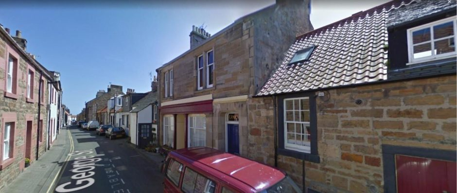 Fife surgeon flashed family