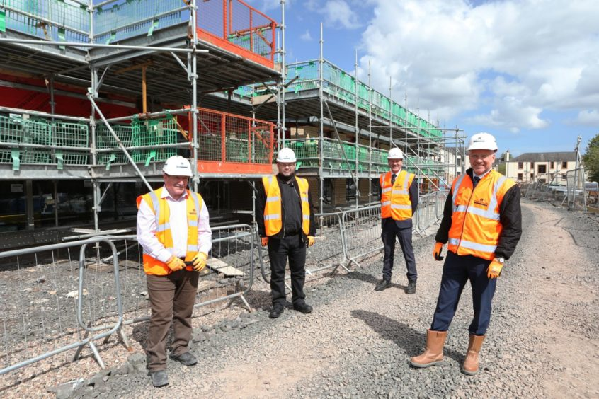 Robertsons project manger Gerry Hampton and managing director Kevin Dickson with councillors Stewart Hunter and Mark Flynn.