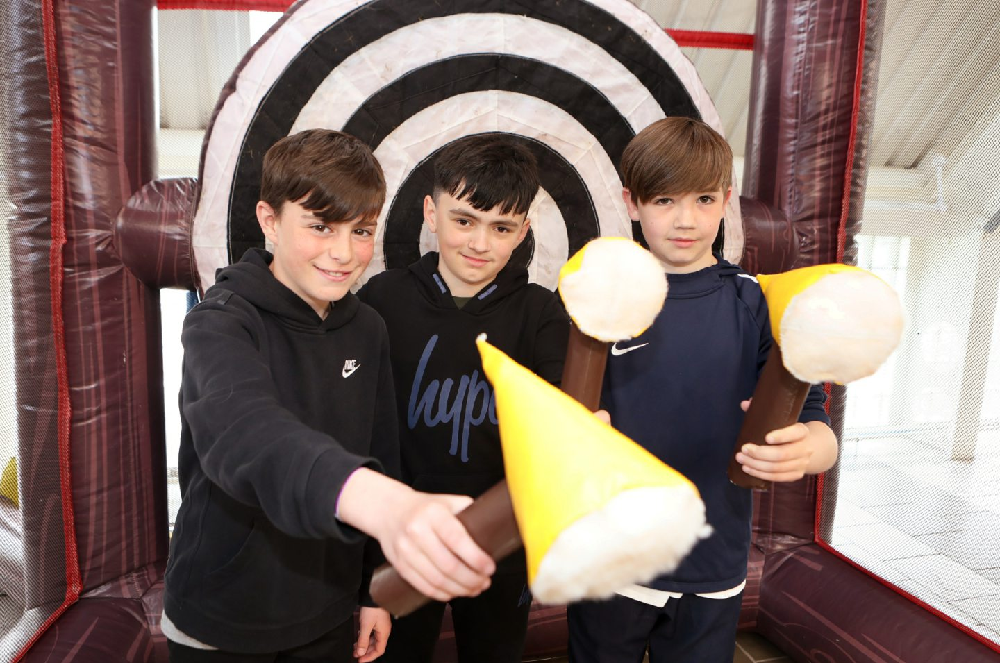 Liam Malone, Steven Hendry and Michael Duff try axe throwing.