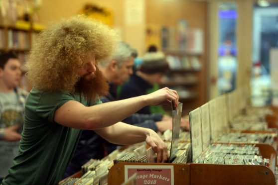 Record collectors browse the shelves of Groucho's.
