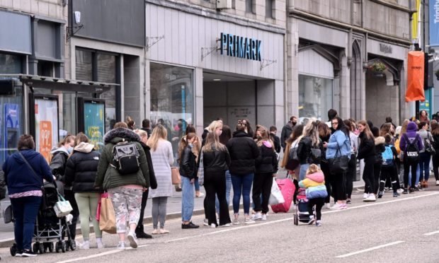 Shoppers queue in Union Street on Monday