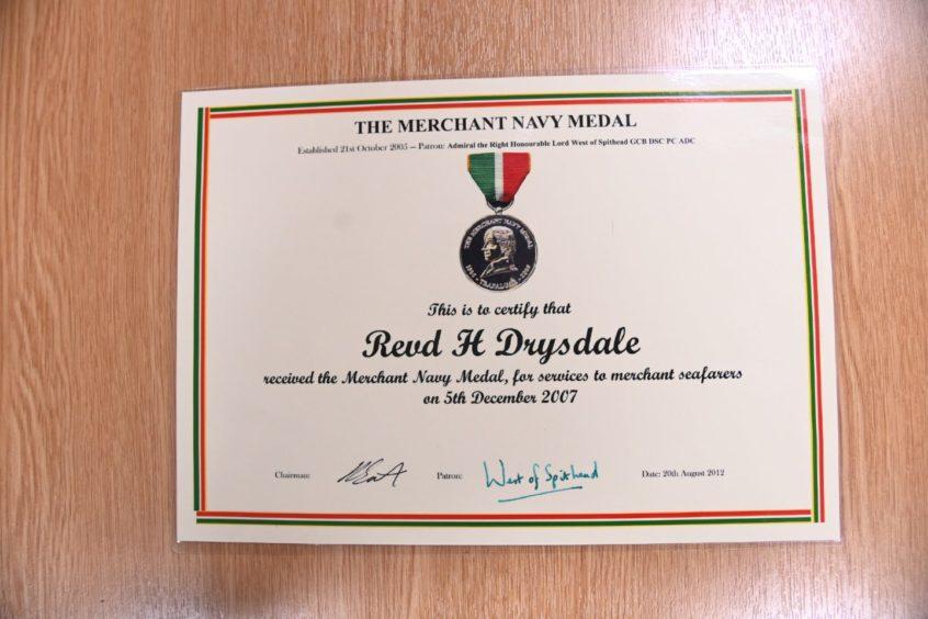 A certificate to 'Revd H Drysdale' awarding the Merchant Navy Medal