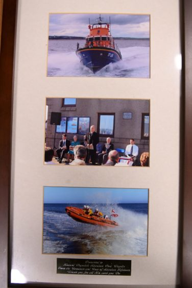 A framed picture featuring three photographs of boats and Howard Drysdale publicly speaking