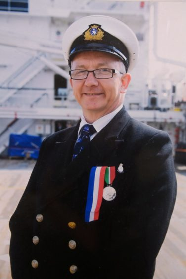 Howard Drysdale in Royal Navy uniform replete with medals