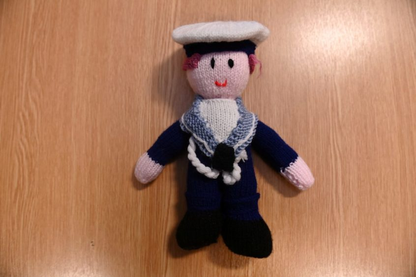 A knitted teddy in the style of a Royal Navy sailor