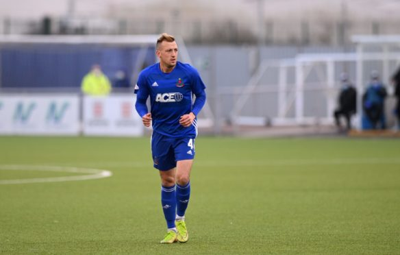 Connor Scully in action for Cove against Partick Thistle.