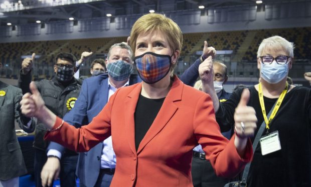 First Minister and SNP party leader Nicola Sturgeon celebrates after retaining her seat for Glasgow Southside.