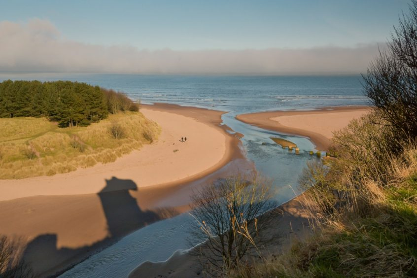 The shadow of Redcastle on the sands at the mouth of the River Lunan.