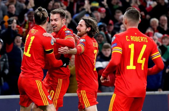 Wales' Aaron Ramsey (second left) celebrates scoring his side's first goal against Hungary in a Euro 2020 qualifier.