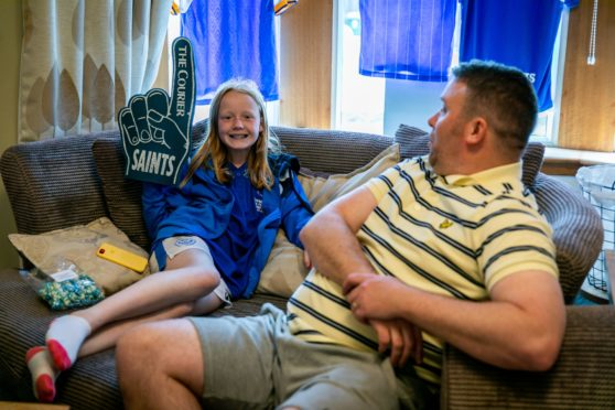 St Johnstone superfans Kev & Emmy watch the Scottish Cup final from their sofa.