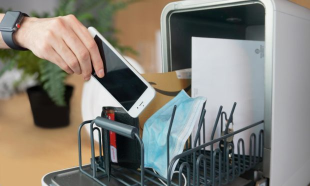 The dishwasher can disinfect and sanitise personal items such as phones, keys and wallets.