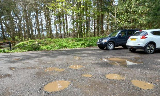 The resurfaced car park, full of potholes
