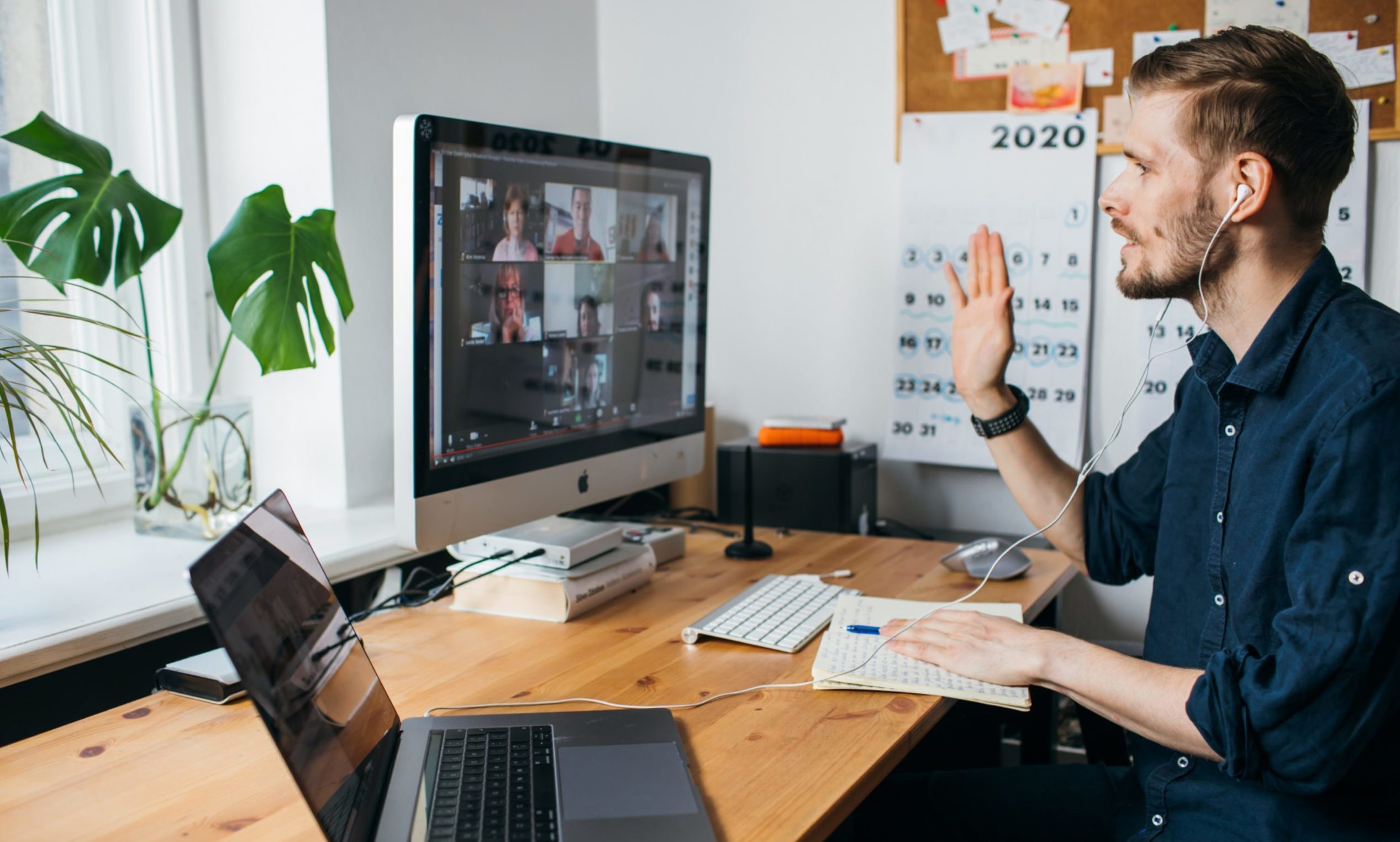 A man takes part in a Zoom video conference.