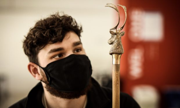 Ben Marshall with one of his stag's head walking sticks.