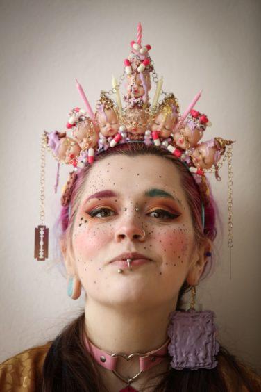 Fine art student Rhiannon Dewar wearing one of her artworks.