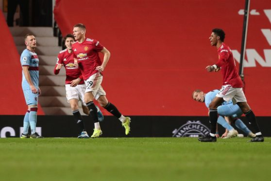 Scott McTominay and Marcus Rashford in action at club level for Manchester United.