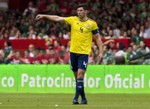 Scott McKenna in action for the Scotland national team.