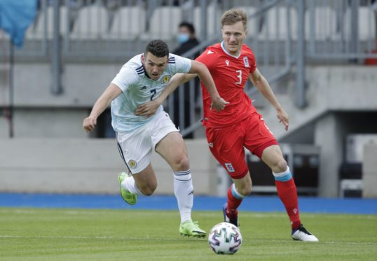 Scotland's John McGinn (left) tussles with Enes Mahmutovic of Luxembourg.