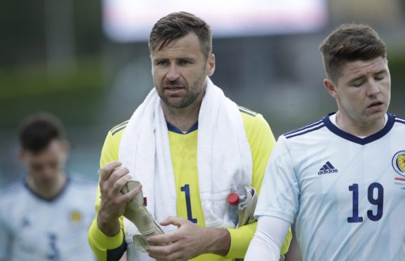 David Marshall in action for Scotland during a friendly against Luxembourg.