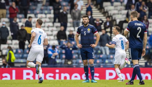 Scotland's Grant Hanley is left dejected after the second goal.