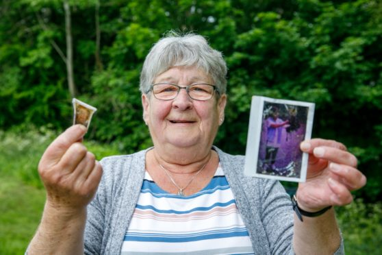 Shelagh with a picture of her mother Agnes (left) and a photograph of her with an owl dating back over 20 years.